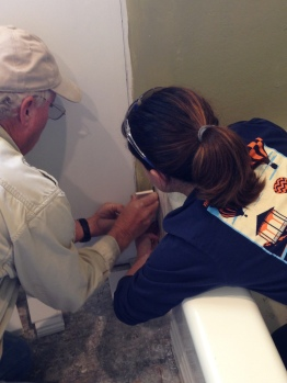 Tile Experts applying the first (of many) subway tiles.