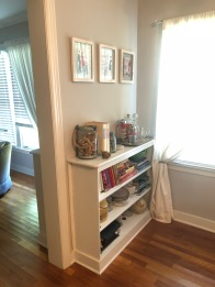 """In the dining room side, the shelve acts as a nice """"dry bar."""""""